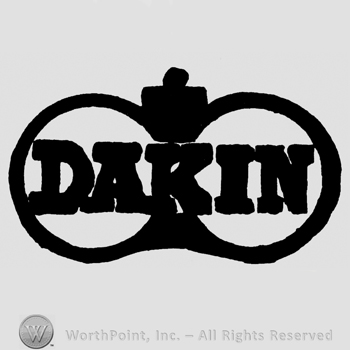 Dakin written with uppercase letters over two circles and a crown